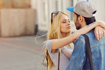 Young hipsters couple in love outdoor