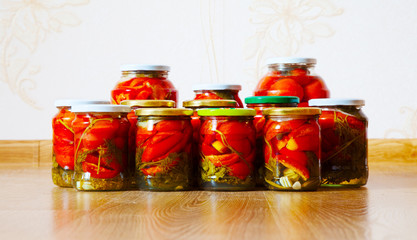 some glass jars with marinated tomatoes homemade
