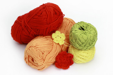 knitting accessories - skeins on white background