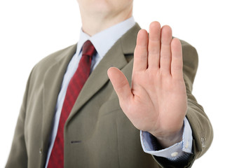 businessman holding up stop palm hand gesture