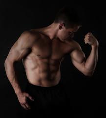 Sexy muscular man on dark background