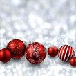 Silver background with red christmas balls.