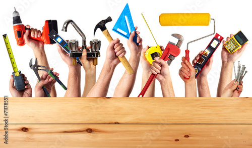 Hands with construction tools. - 71178551