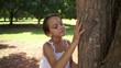 9of18 Happy school girl hugging tree in park, ecology
