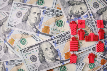red gift ribbon with bow over american dollars. money background