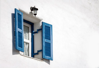 blue vintage windows on white cement wall