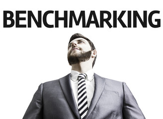 Business man with the text Benchmarking in a concept image