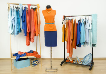 Dressing room with complementary colors orange and blue clothes.