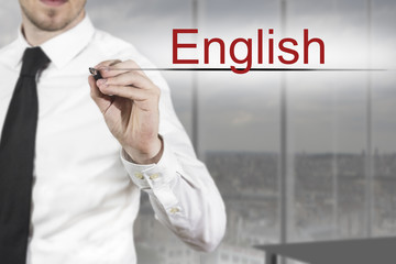 businessman writing english in the air