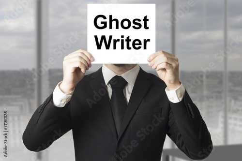 Poster businessman hiding face behind sign ghost writer