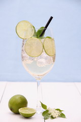Hugo cocktail with lime, mint and elderflower syrup