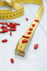 Goji berries and tape measure, concept of health