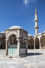 Ablution fountain and minaret of the Blue Mosque