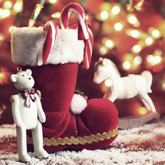 boots, rocking horse, and teddy bear on christmas background