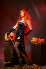 red-haired girl in the image of the witch. brew a potion