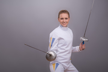 Young woman engaging in fencing