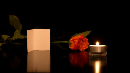 Card with Rose and Candle on Shiny Black Surface