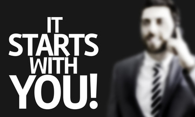 Business man with the text It Starts With You!