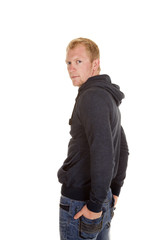 man in a hoodie back hands in pockets