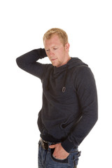 man in a hoodie hand on back of head one in pocket