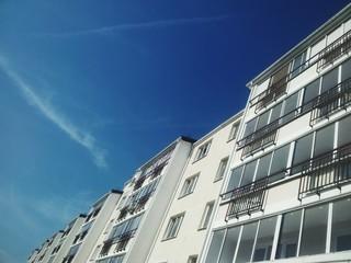 Modern building on blue sky background