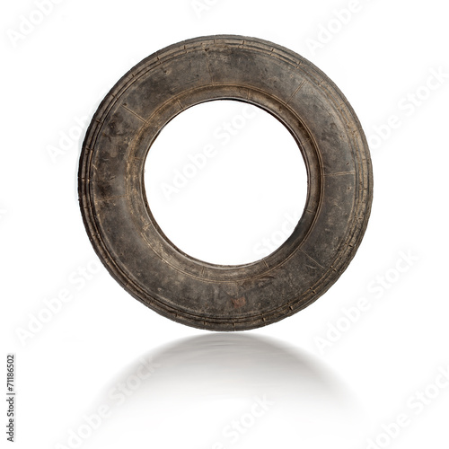 Small old dirty tire isolated - 71186502