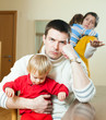 Young family conflict. Young upset  man against sadness woman