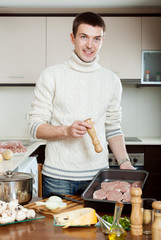 Guy cooking meat