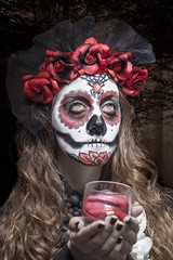 A woman in Halloween costume and skull makeup