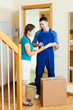 courier in uniform brought package to housewife