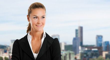 Smiling businesswoman with city in the background