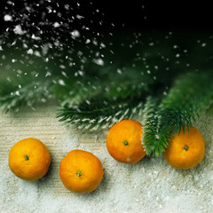Christmas decor, tangerines and snow