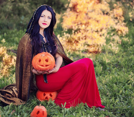 beautiful witch with pumpkin