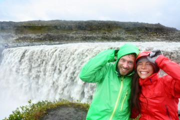 Travel couple fun by Dettifoss waterfall, Iceland