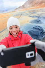 Iceland tourist selfie at mudpot hverir hot spring