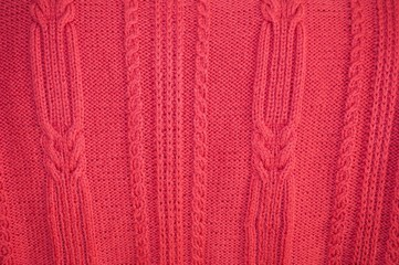 Background texture of knitted red pullover