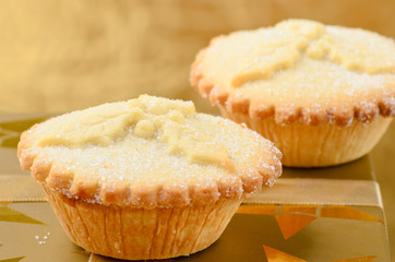 Two golden mince pies, a traditional christmas sweet.