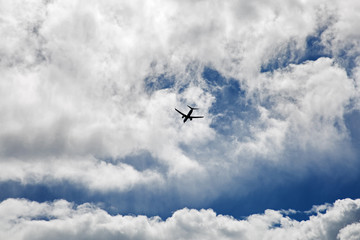Passenger plane flying in the clouds