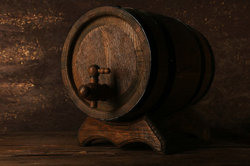 Barrel on wooden table on wooden wall background