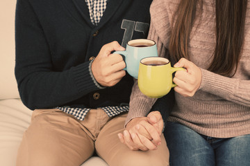 Young couple drinking tea, close-up