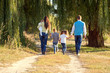 Big family walking in the park.