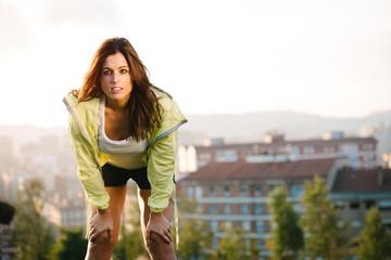 Sporty woman taking break from training