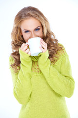 Woman Wearing Green Sweater Drinking from Mug