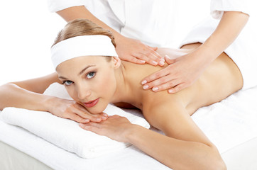 Woman Getting Shoulder Massage from Masseuse