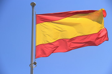 Spain flag without coat of arms to blue sky
