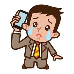 電話中に泣くビジネスマン
