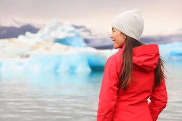Woman at glacier lagoon on Iceland