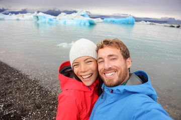 Couple taking selfie by Jokulsarlon on Iceland