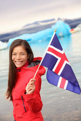 Iceland - girl holding Icelandic flag at glacier