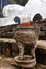 Sticks Burning Outside of Lying Buddah statue.